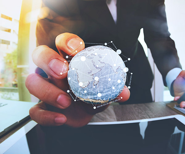 REALTOR® holding a globe to represent the Interactive Map Search on their real estate website