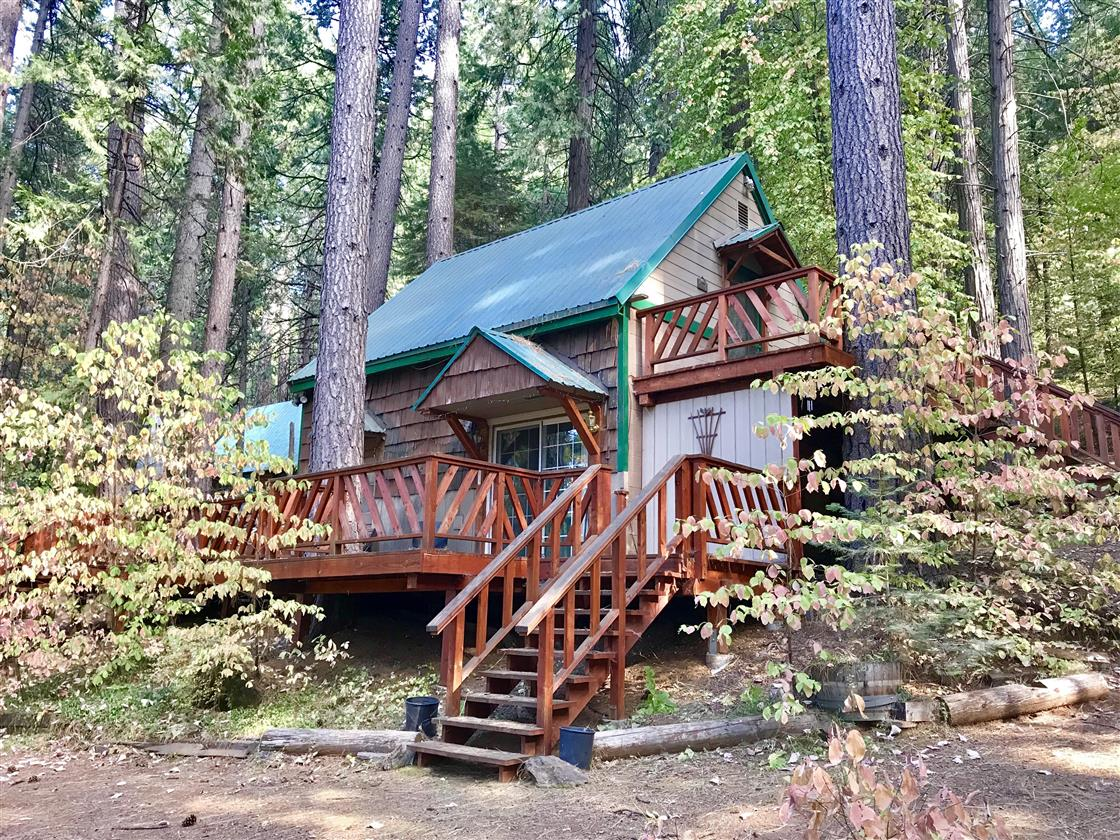 Tucked in the Dogwood and pines just across the street from your private owners only Fly In Lake. Newer deck off of great room and upstairs bedroom has its own deck as well. Cabin has great room and full bathroom on main level. Pine vaulted ceiling.