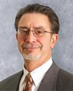 Joseph E Tine