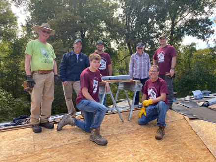Day of Service roofing crew partnered with Good Neighbors