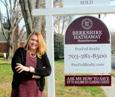 Agent next to Sold Sign