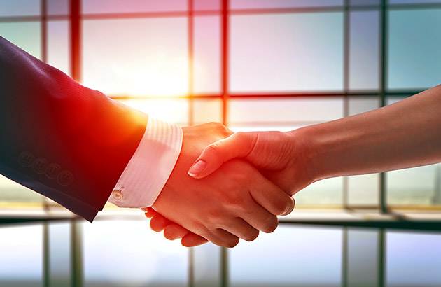 When to stop negotiating - a man and a woman shaking hands