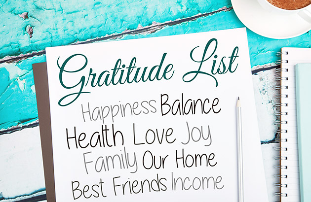 Gratitude list concept with paper and pencil