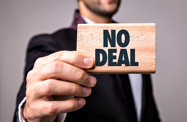 When to walk away - person holding up No Deal sign