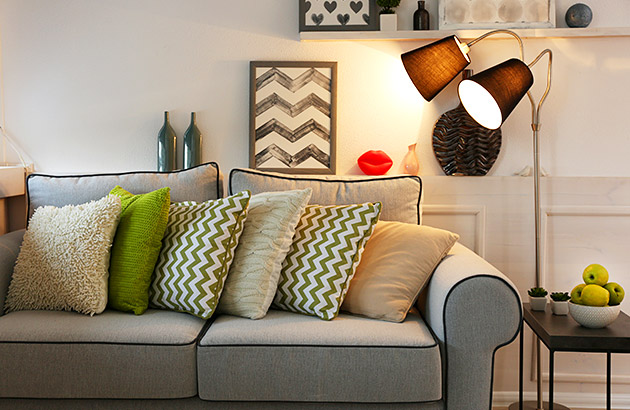 A warmly decorated family room with nice lighting and textures