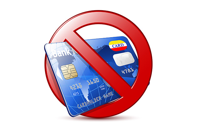 Concept art showing a credit card surrounded by a red circle with a slash through it