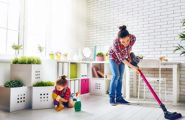 Happy family cleaning dust and vacuuming
