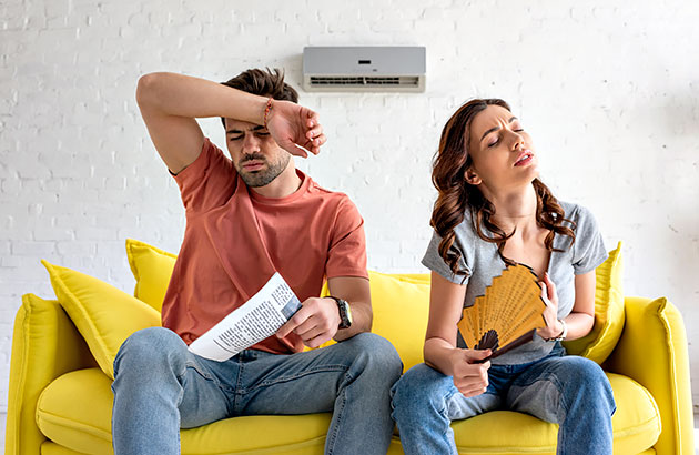 A frustrated couple contemplating solutions to their HVAC problem