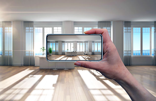 A smartphone taking a photo of an empty space