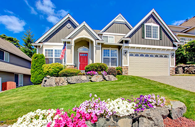 Curbside view of beautifully landscaped front yard of home