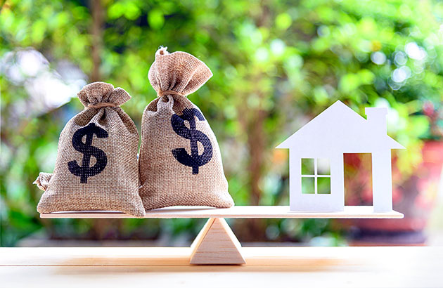 What is home equity - illustration of money and house in balance